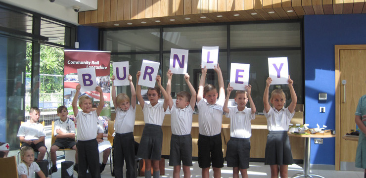 Burnley school children welcome European partners in style